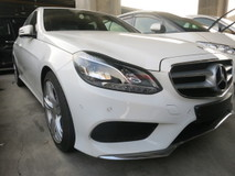 2013 MERCEDES-BENZ E-CLASS E250 2.0 AMG SPORT WITH 2 MEMORY SEATS ELECTRIC SEATS REVERSE CAMERA 1 YEAR WARRANTY MULTI FUNCTION STEERING PADDLE SHIFT LOCAL AP AUTO CRUISE CONTROL iDRIVE CLIMATE AIRCOND CONTROL SYSTEM ADJUSTABLE SIDE MIRROR  AMG SUSPENSION 18 RIM BUCKET HALF LEATHER